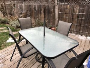 Patio table and 4 chairs (umbrella base not incl)