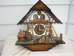 New German cuckoo clock 8 day movement Chalet style with Swiss musical movement