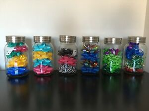 Large collection of gift bows and huge mason jars