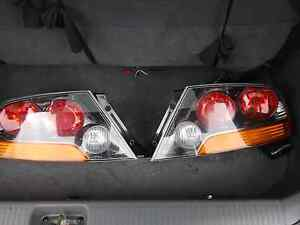 Rear Tail Lights from a  Mitsubishi Evolution 9 Woodcroft Blacktown Area Preview