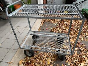 Galvanized Cart with pneumatic wheels.
