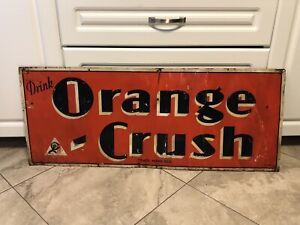 Signs signs signs door push bars & more orange crush Coca Cola..