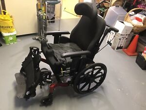 Recliner wheelchair with head rest