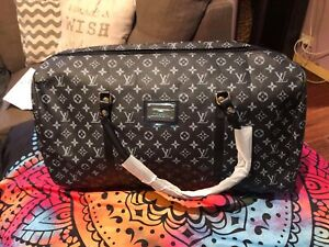 Louis Vuitton over night bags