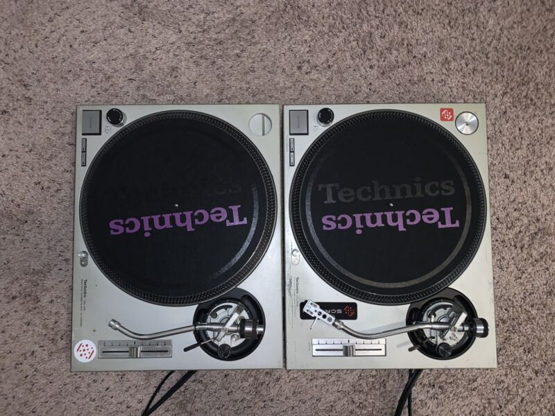 Pair of Technics SL-1200MK2 Turntables W/ Technics Slipmats and 2 hard Cases