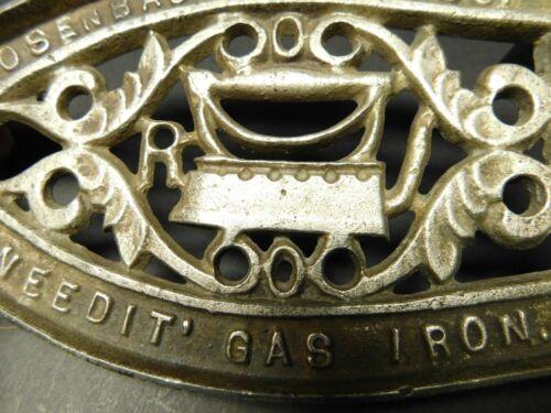 "Cast Iron Footed Sad Iron Trivet - Advertising Rosenbaum MFG Co. ""Uneedit Gas"""