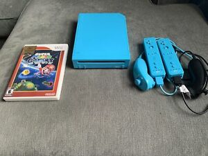 Nintendo Wii Teal with Wiimotes and nunchucks & Mario Galaxy