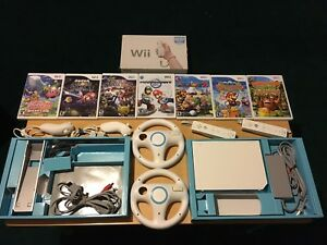 Wii bundle modded system with 7 games mario kart ,