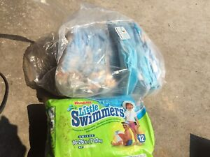 Young child swimming diapers