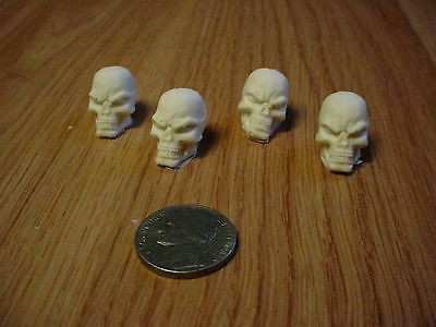 4 Resin Cast Skulls Evil Face 7/8