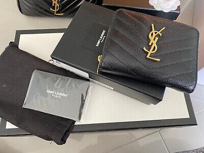 YSL monogram Compact Zip Around Wallet. Black. Grain Embossed Leather.