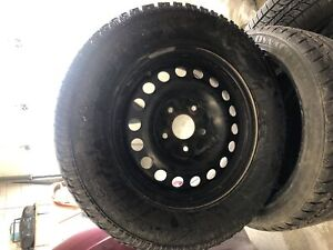 215/70/16 Avalanche Extreme snow tires and rims Caravan Journey