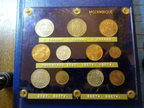1936 1 Escudo and 10 others in a old lucite holder Mozambique
