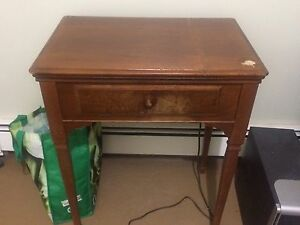 Antique singer sewing machine in caninet
