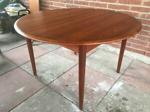 "Mid century modern Teak dining table - 47"" D x 29"" H"