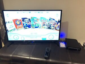 Nintendo Wii - Comes with Thousands of Games!
