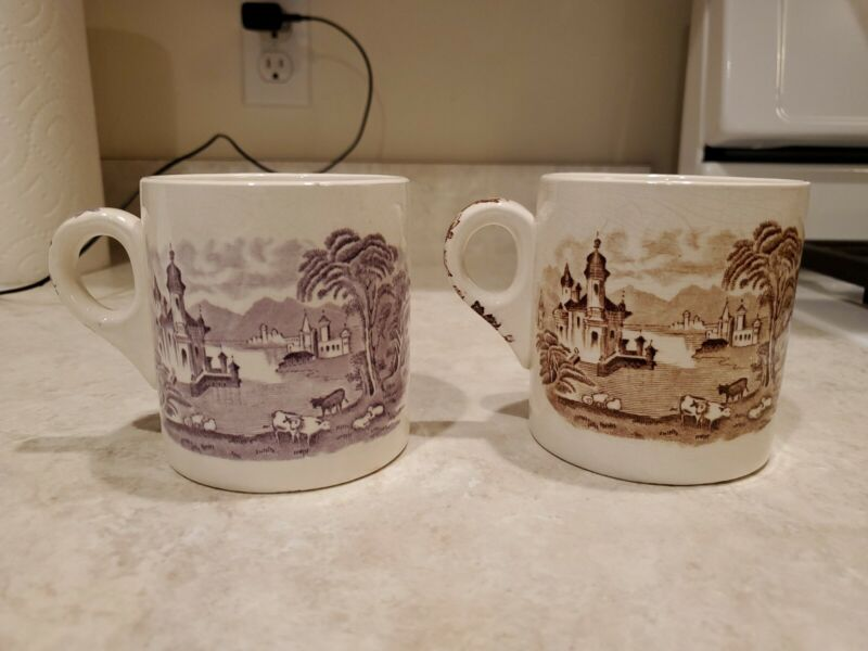 1 BROWN AND 1 PURPLE COFFEE CUP MALING WARE NEW-CASTLE-ON-TYNE ENGLAND