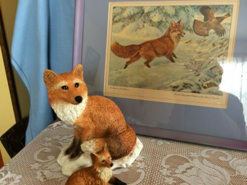 Fox figurines with fox picture wall and shelf decor