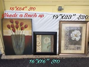 Various wall hangings, photos, photo books and picture frames