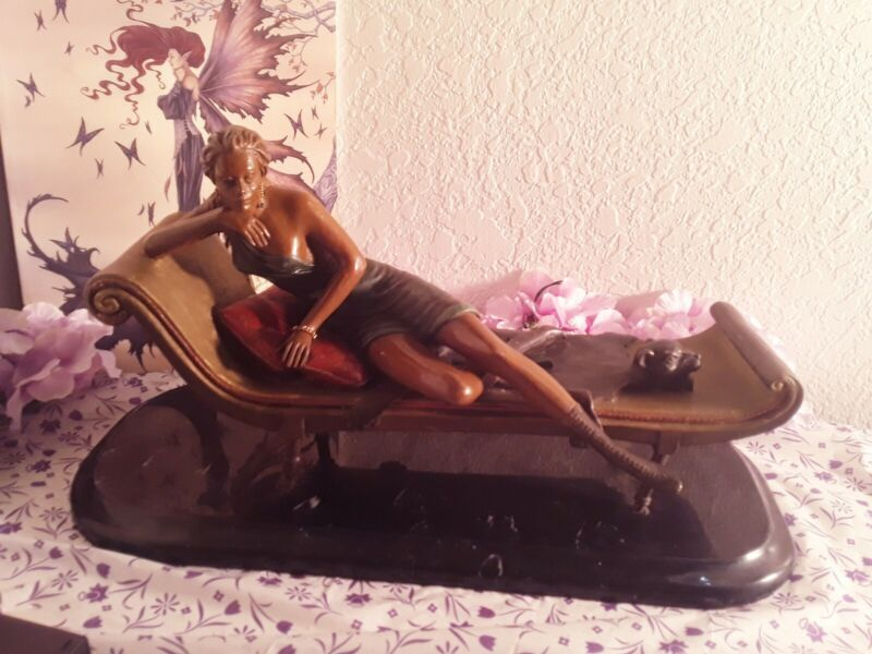 ANTIQUE  ART DECO BRONZE SCULPTURE of a lady on a day bed with  bear rug VINTAGE