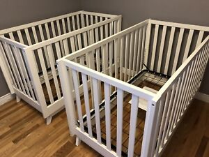 2 white 4 in 1 convertible cribs in excellent condition