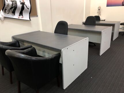 3 deaks with 3 typing chairs. one desk missing a drawer
