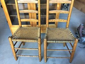 Two vintage ladder back chairs