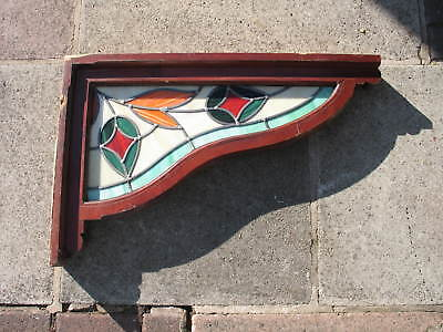 Leaded coloured glass in angle frame