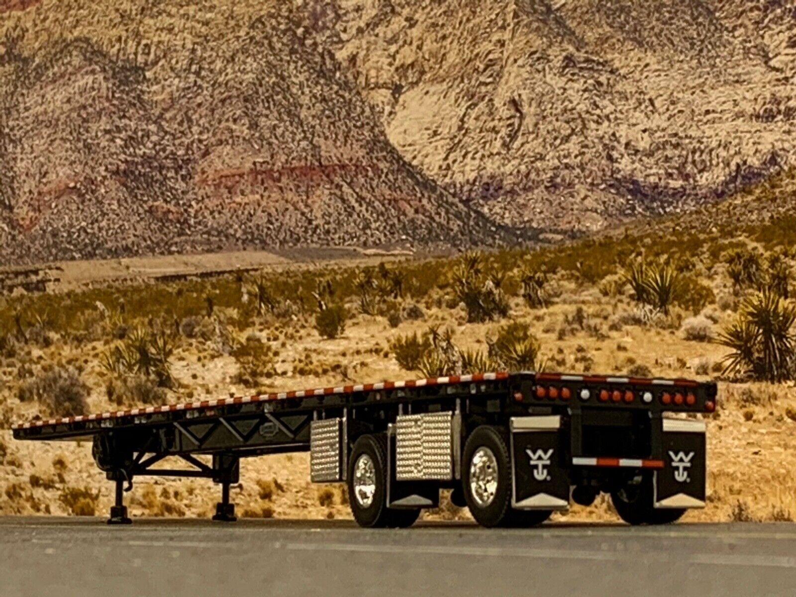 1/64 DCP BLACK WILSON ROADBRUTE SPREAD AXLE FLATBED TRAILER W/ WHEEL & TOOL BOX