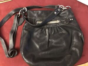 Roots black leather purse