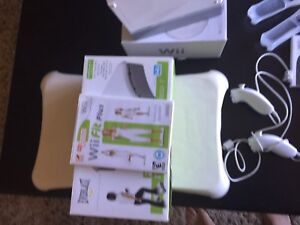 Nintendo Wii with original packaging and Wii fit