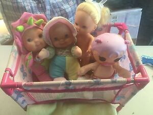 Dolls cot + 4 dolls. Kuluin Maroochydore Area Preview