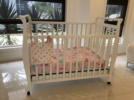 Baby cot with mattress and baby bouncer in excellent condition.