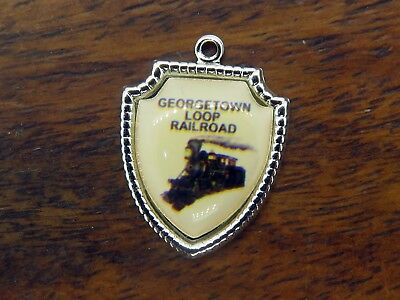 - Vintage silver GEORGETOWN LOOP RAILROAD TRAIN COLORADO TRAVEL SHIELD charm #E11