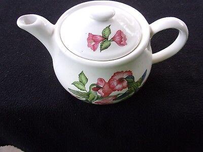 Vintage porcelain tea pot, hummingbird and hibiscus floral design.