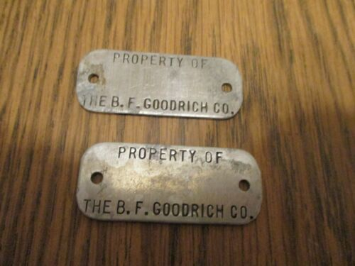TWO PROPERTY OF THE B.F. GOODRICH CO. METAL TAGS