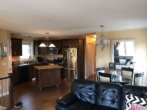 Part. Furnished 3 bed/2 main floor house. Utilities incl.