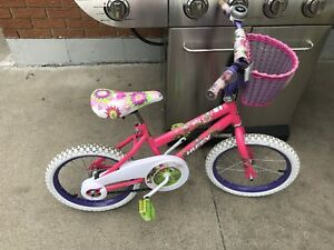 Girls Huffy bike with basket and bell