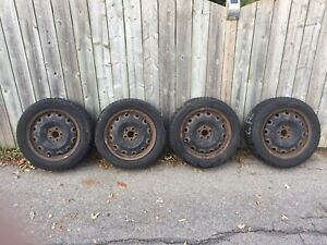 Set of four rims with lug nuts