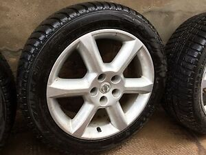 "Nissan oem maxima 18"" rims with winter tires"