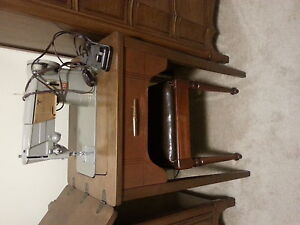 Singer sewing machine cabinet with stool