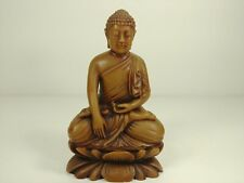 buddhist buddha monk lotus position praying figurine on