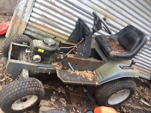 Old riding lawn mower pull tractor