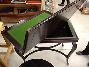 Antique swivel top card table