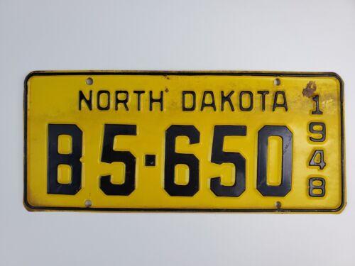 1948 North Dakota License Plate black & yellow B5-650 flat & straight