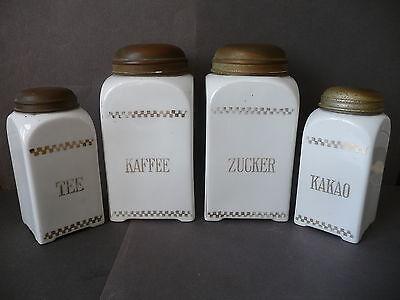 4 alte Vorratsdosen aus Porzellan mit Metalldeckel Kaffee Tee Zucker Kakao