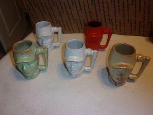 Five vintage Frankoma Pottery Golfer Head Mugs