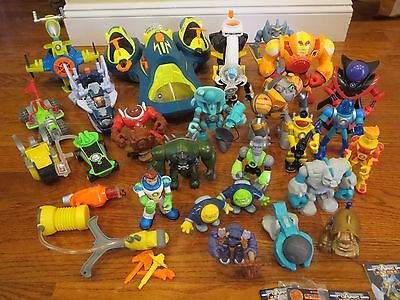 HUGE LOT Fisher Price PLANET HEROES 18 Figures + 7 Vehicles + Accessories + DVDs
