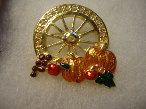 Vintage/nos enamel rhinestone Pumpkin Wheel fall pin