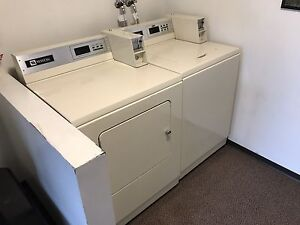 Coin operated pay laundry machines available.